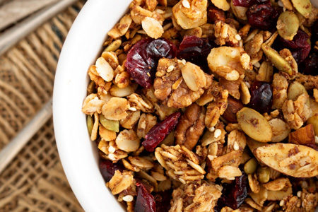 Homemade granola and cranberries on breakfast table